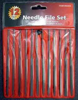 d877af6f32a A set of twelve different needle files, perfect for shaping small holes in  control panels or any other